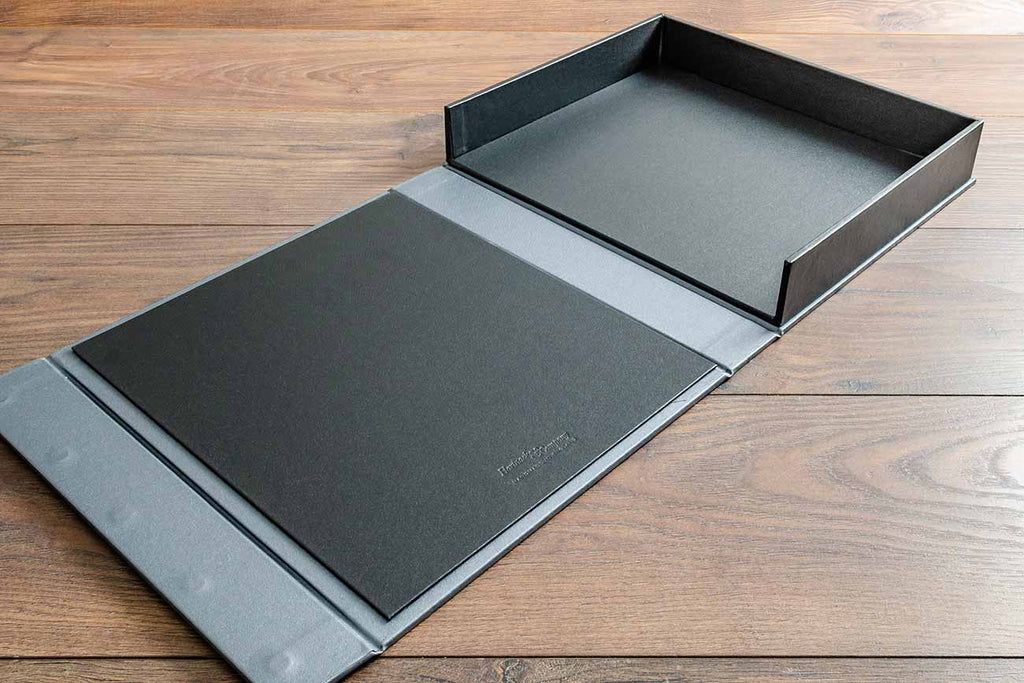 The clamshell vehicle document box is lined inside in charcoal buckram and has a magnetic closure flap