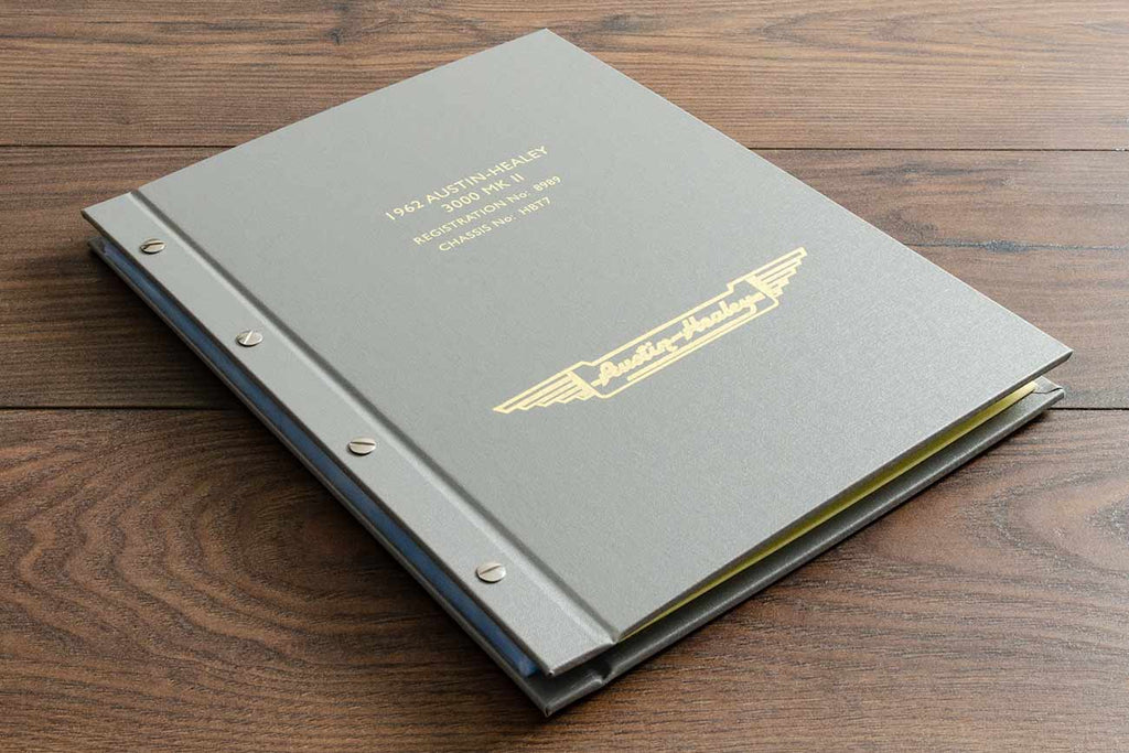 Personalised exposed screw post vehicle document portfolio for Austin Healey 3000 in beige buckram with yellow foil