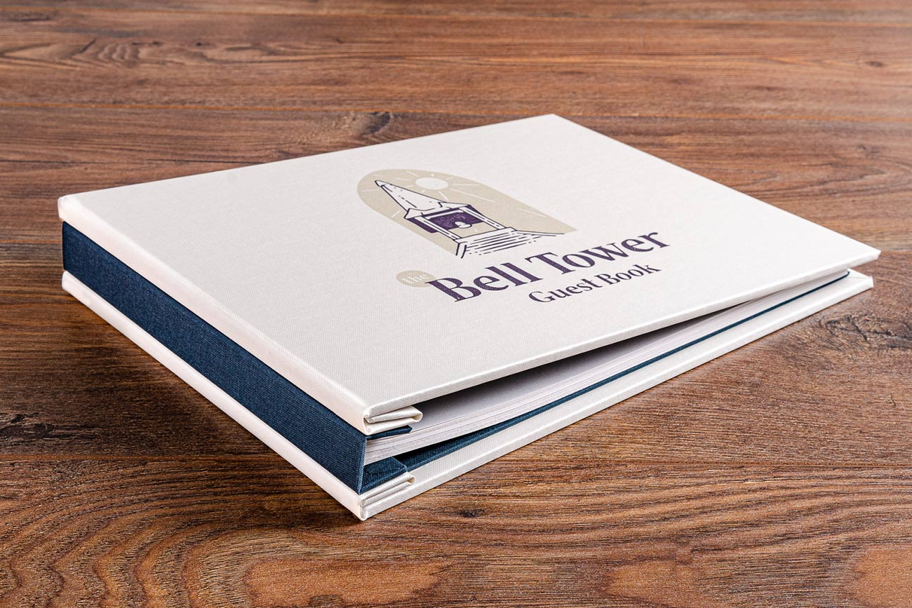 Custom made guest book in white buckram and moreton blue book cloth