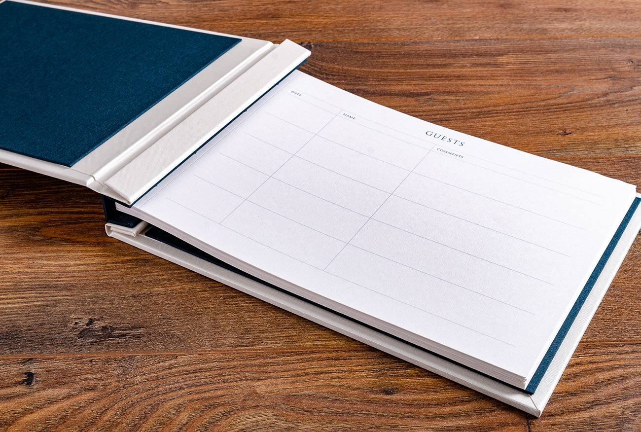 The guest book binder is a hidden screw post and the pages follow the standard H&Co format and were printed out by us
