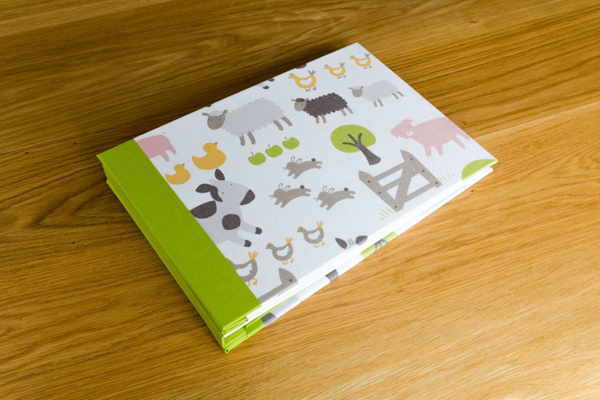 A5 bespoke baby scrapbook handmade with cotton fabric as book-cloth and embossed name on spine