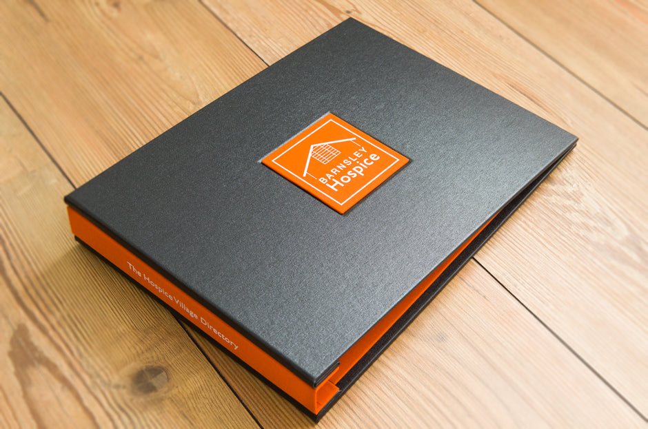 A4 landscape portfolio binder in charcoal buckram, solo orange book cloth and a name plaque