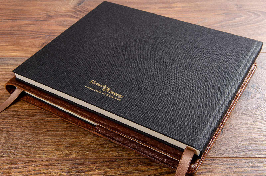 Hard cover guest book and leather book cover hand made by Hartnack and Company England