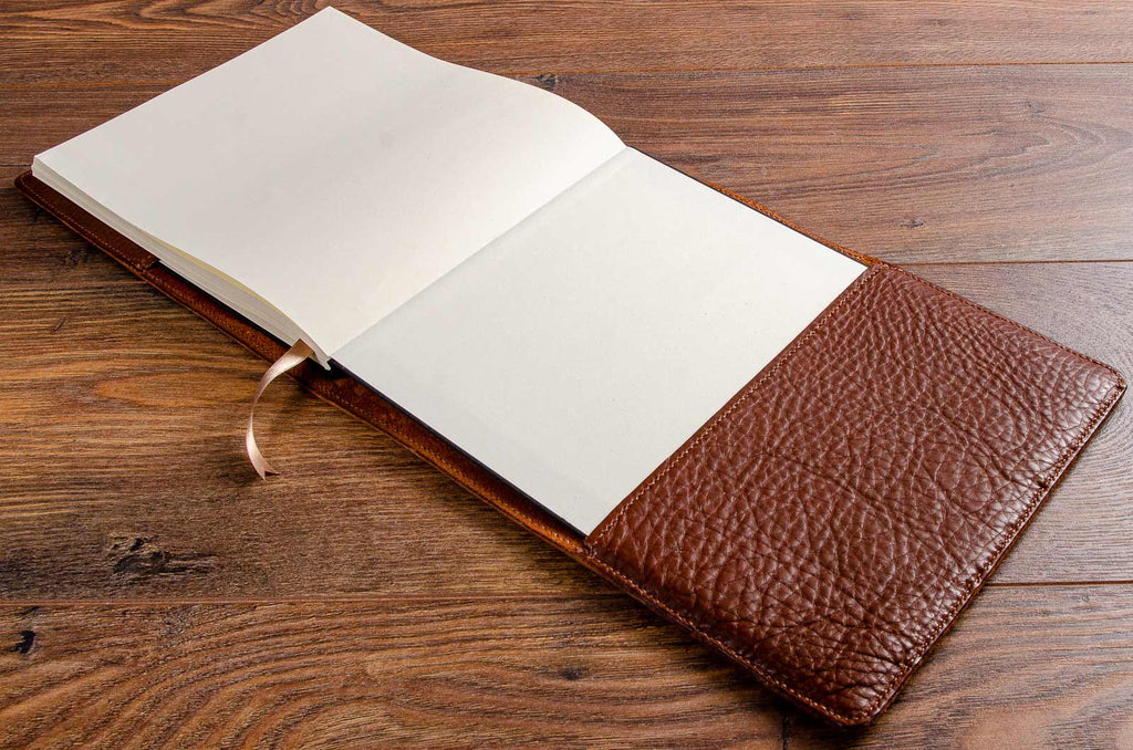 The hard cover book fits snugly and securely into its hand stitched leather book jacket