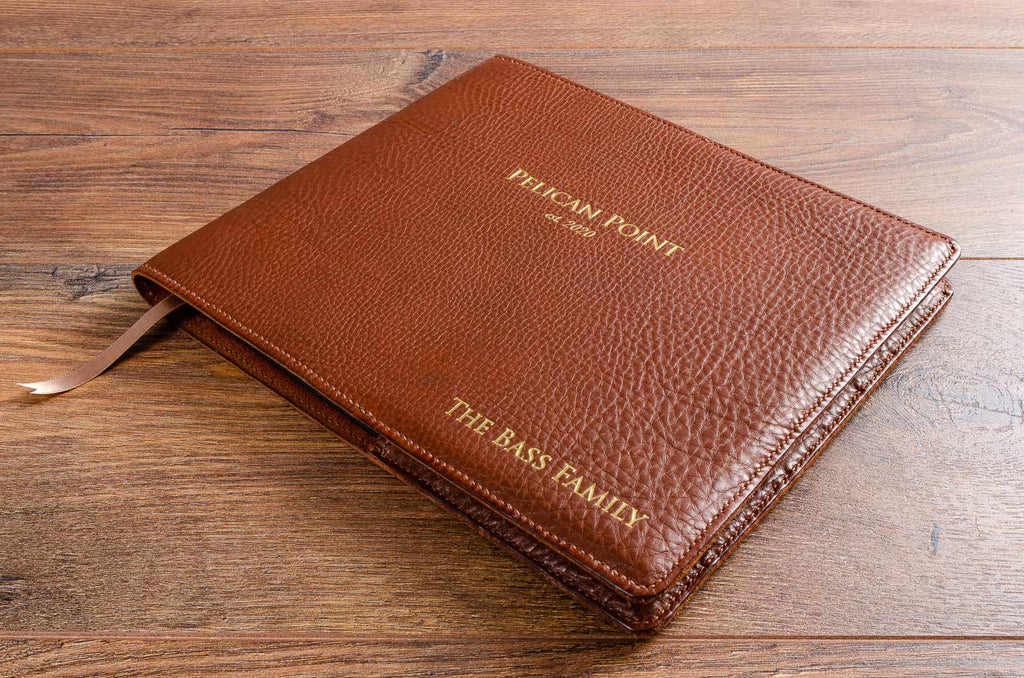Handmade personalised leather book jacket cover with gold foil embossed inscription