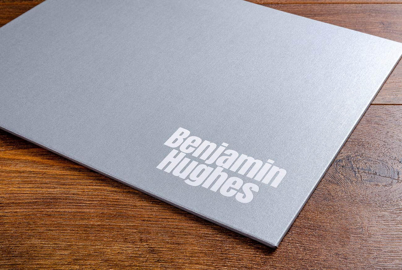 White foil stamping on photographers portfolio book cover
