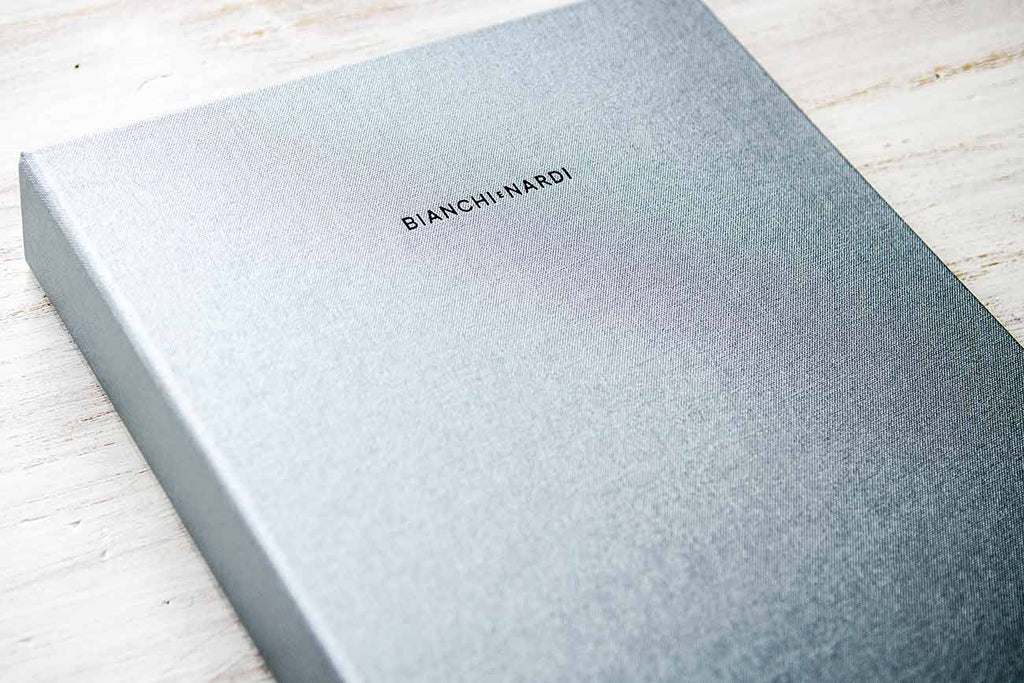 A4 portrait ring binder in Platinum coloured buckram with black foil personalisation