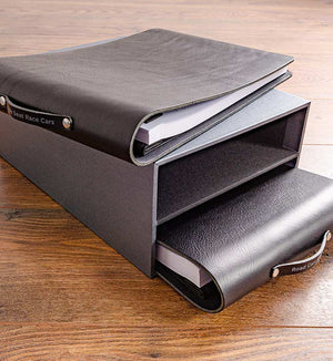 Black leather folders and slipcase for classic car collection