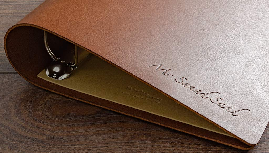 Blind emboss personalisation on custom made brown leather surgical portfolio