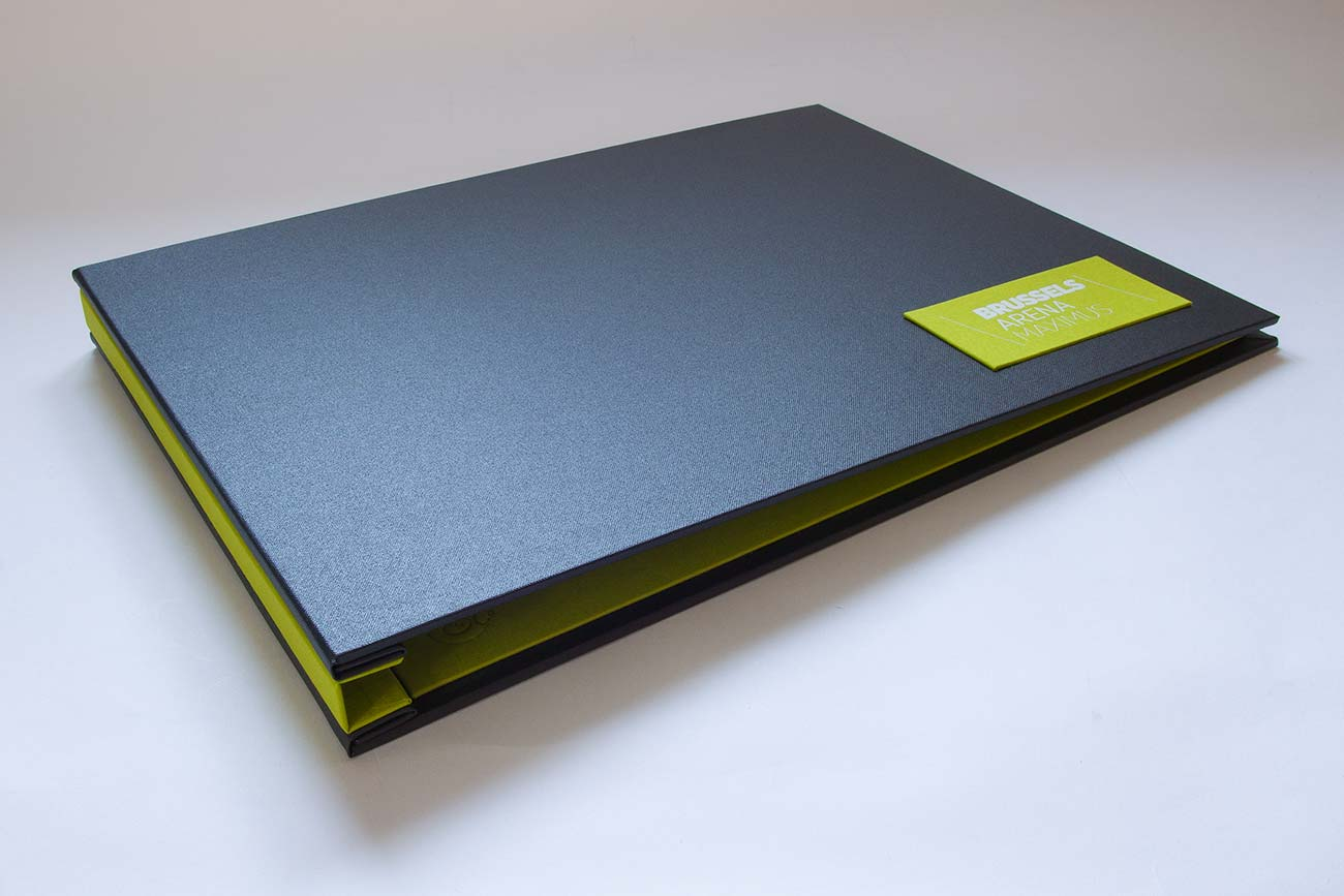 A3 custom presentation portfolio book in charcoal and green with name plaque and white foil