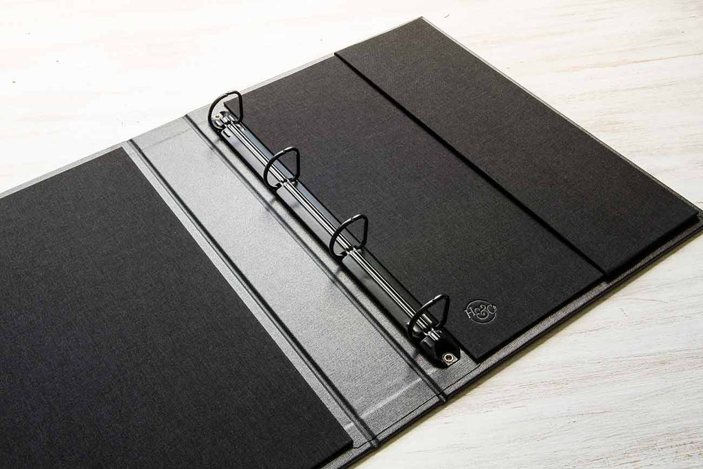 Black 4 ring 2.5cm ring binder mechanism in an A4 portrait binder with a Black book cloth inner cover and vertical back pocket