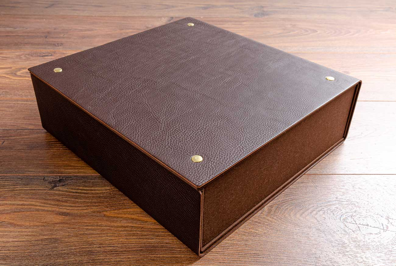 Leather box file for vehicle restoration and documents riveted with brass rivets