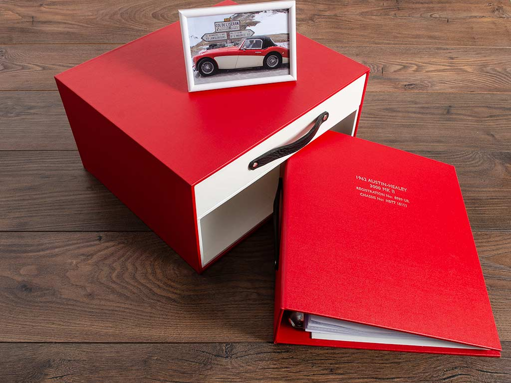 The ring binder is for the car's history and invoices and is personalised with the Austin Healey 3000 chassis and registration number on the cover