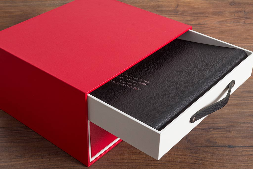 The top drawer of the box set contains a black leather album with personalised cover. The album contains restoration photographs and vehicle history and will be place on the Healey's bonnet at classic car events