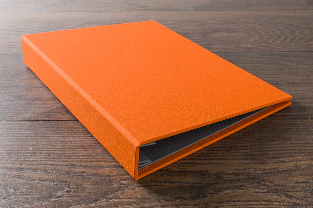 A4 portrait case bound screw post portfolio in solo orange book cloth