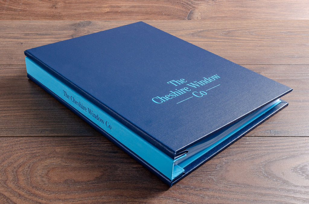 A4 portrait custom sales binder in Petrol blue buckram and Brillianta blue book cloth