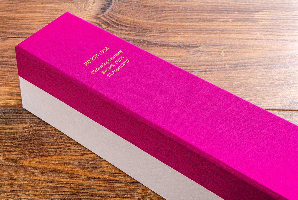 Gold foil personalisation on the spine of the christening presentation box