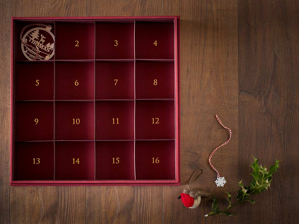 Christmas decoration keepsake box with numbered compartments in gold foil with christmas decoration