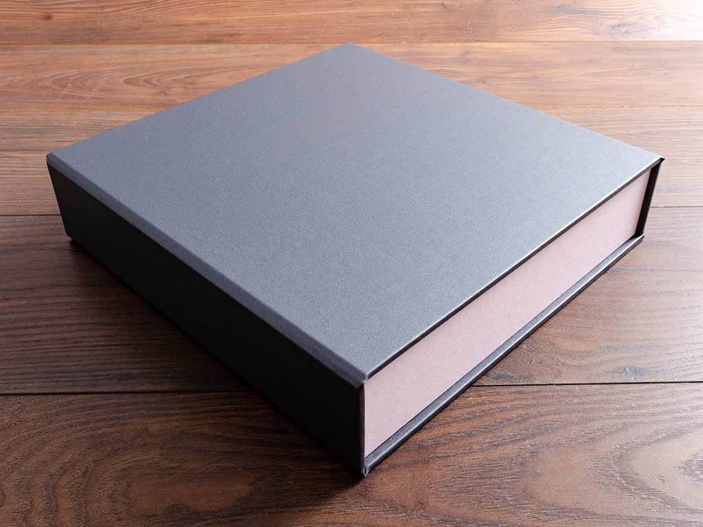 custom made 12x12 clamshell box binder in platinum buckram and calamine pink