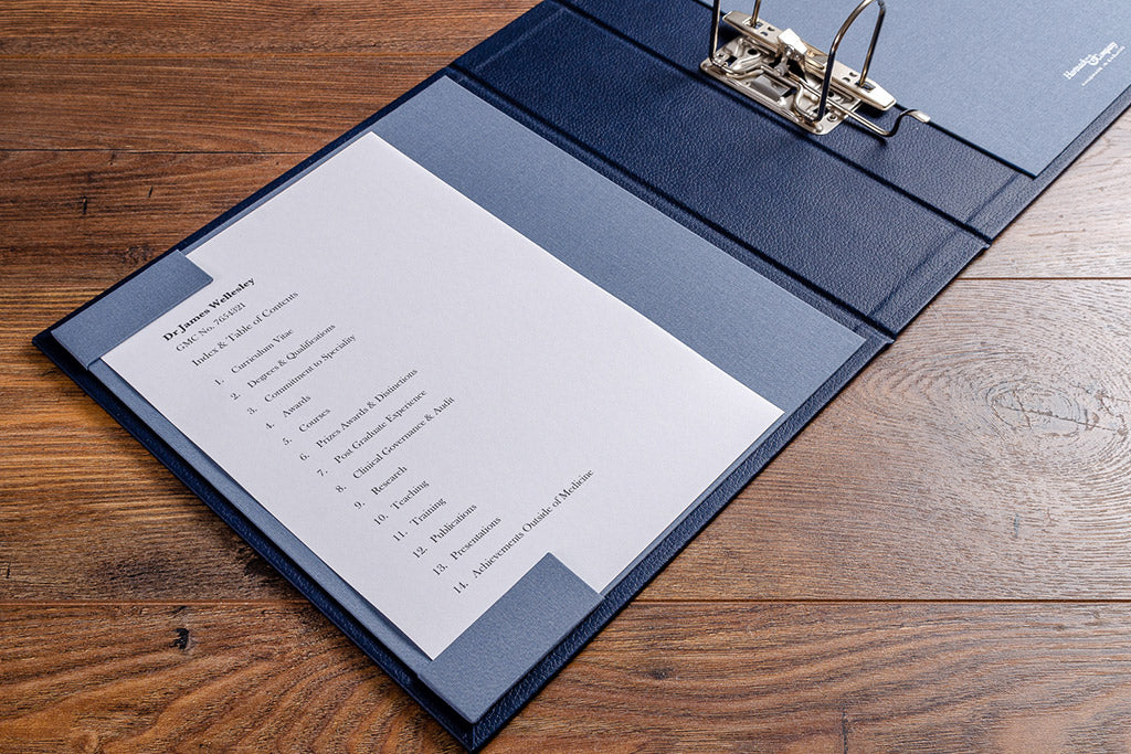 Contents page holder for a medical portfolio and surgical portfolio