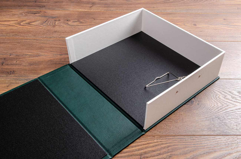 Bespoke A4 clamshell box file with spring clip mechanism for racing cars history and provenance