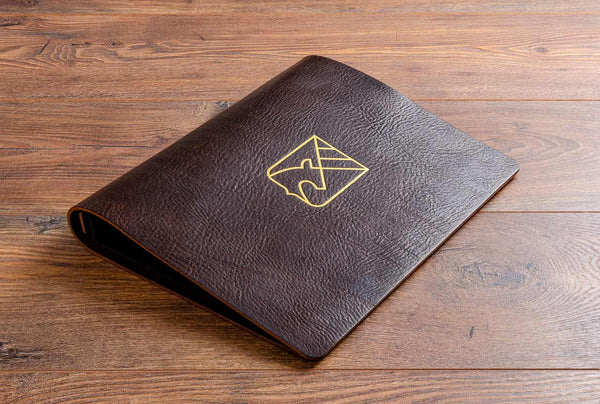 A4 landscape menu cover in dark brown waxy leather with cover personalised in gold foil