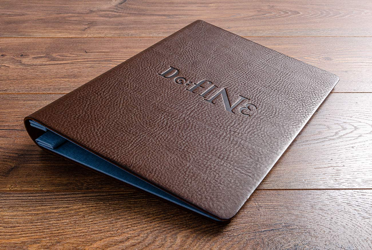 A4 leather menu in dark brown 2.5mm veg tanned leather with blind deboss stamping on the front cover.