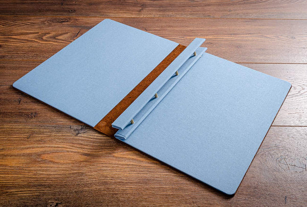 Inner covers in blue book cloth of A4 leather menu cover with screw post binder mechanism