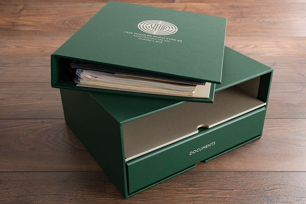 The double slipcase box has notches so that you can get easy access to the binders and is also fully lined with a matching colour fabric