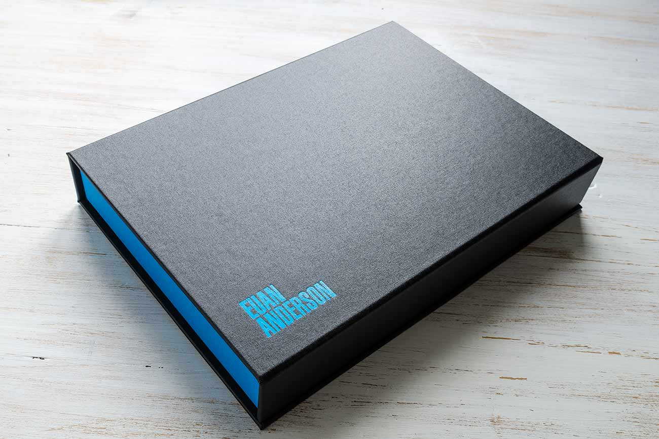 Design and photography clamshell portfolio box - Charcoal buckram outer cover with blue foil personalisation and brilliant blue book cloth trays