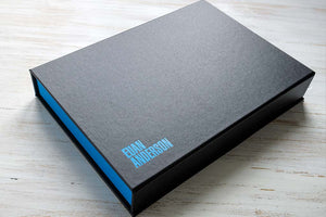 photography portfolio box in charcoal black and blue with blue foiled personalised cover