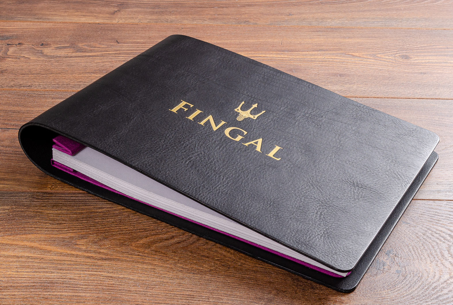 Black leather guest book with gold foil embossing