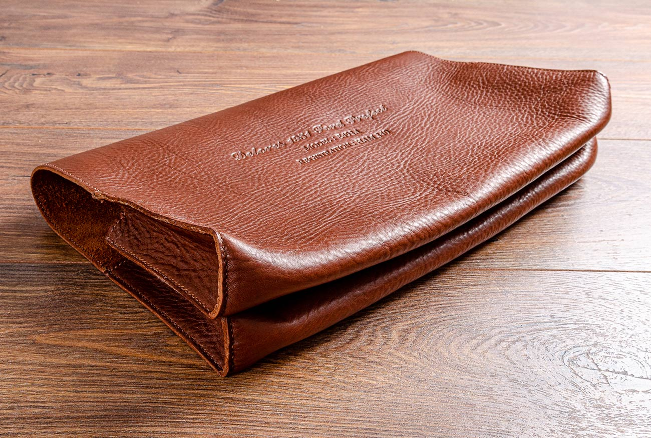 Double pocket document wallet in medium brown veg tanned Italian leather