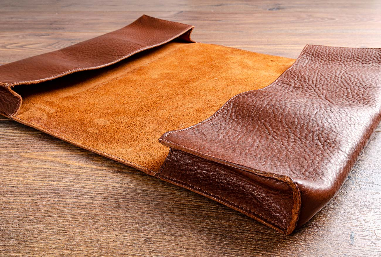 The leather document wallet was hand cut and then hand stitched