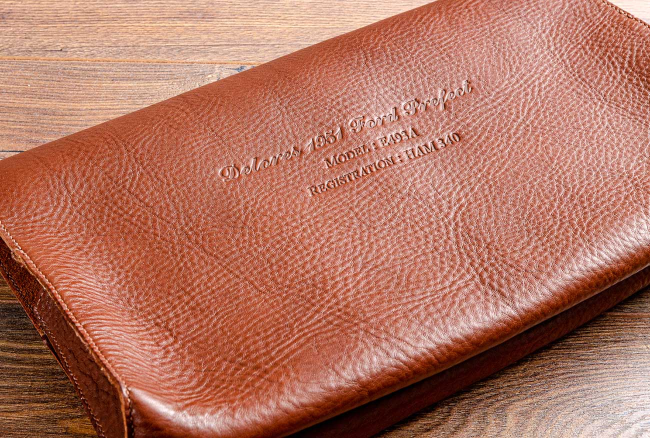 The cars details were then blind embossed on the cover the leather document wallet