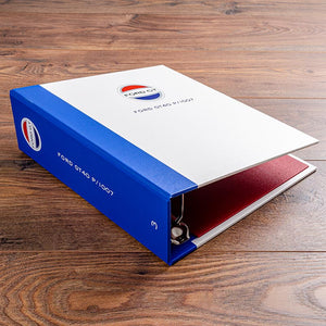 The spine for vehicle document binder is in a blue buckram to match the racing colours if the car and is also full colour printed with the logo and chassis number on the spine