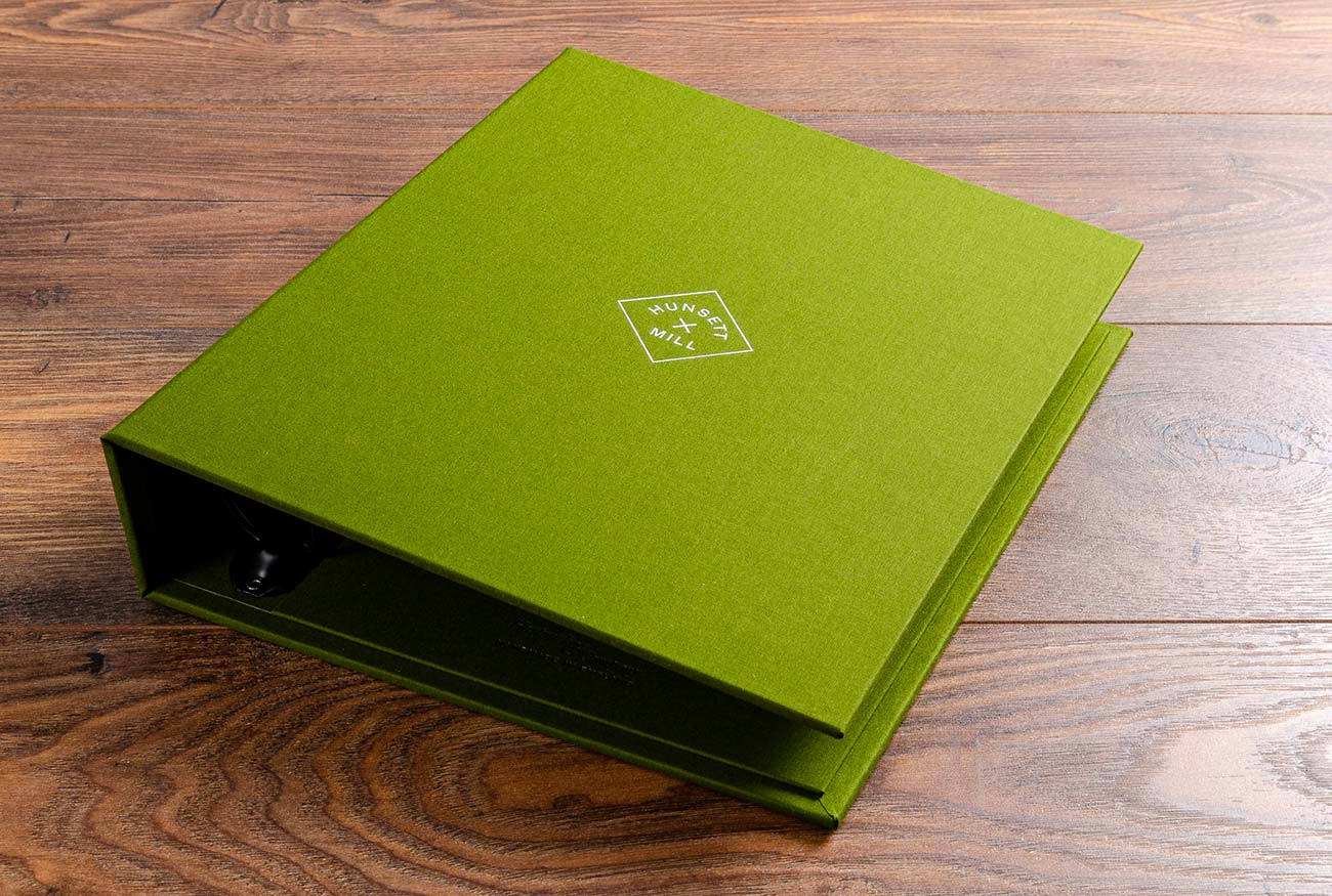 A4 guest manual ring binder in Parana green book cloth with white foil embossing