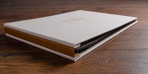 A photographers portfolio book with a personalised embossed cover