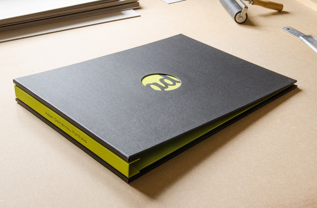 A3 photography portfolio in Charcoal buckram and Doon green inner cover and spine. Also with a round recessed window and black foiled personalisation