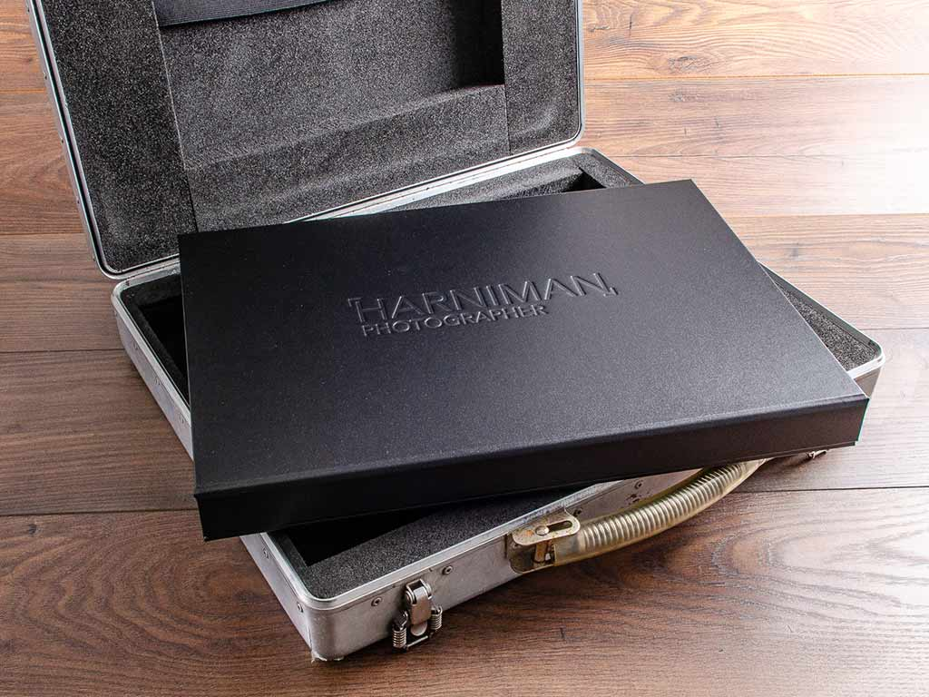 photography portfolio box sitting on carry case by hartnack and co