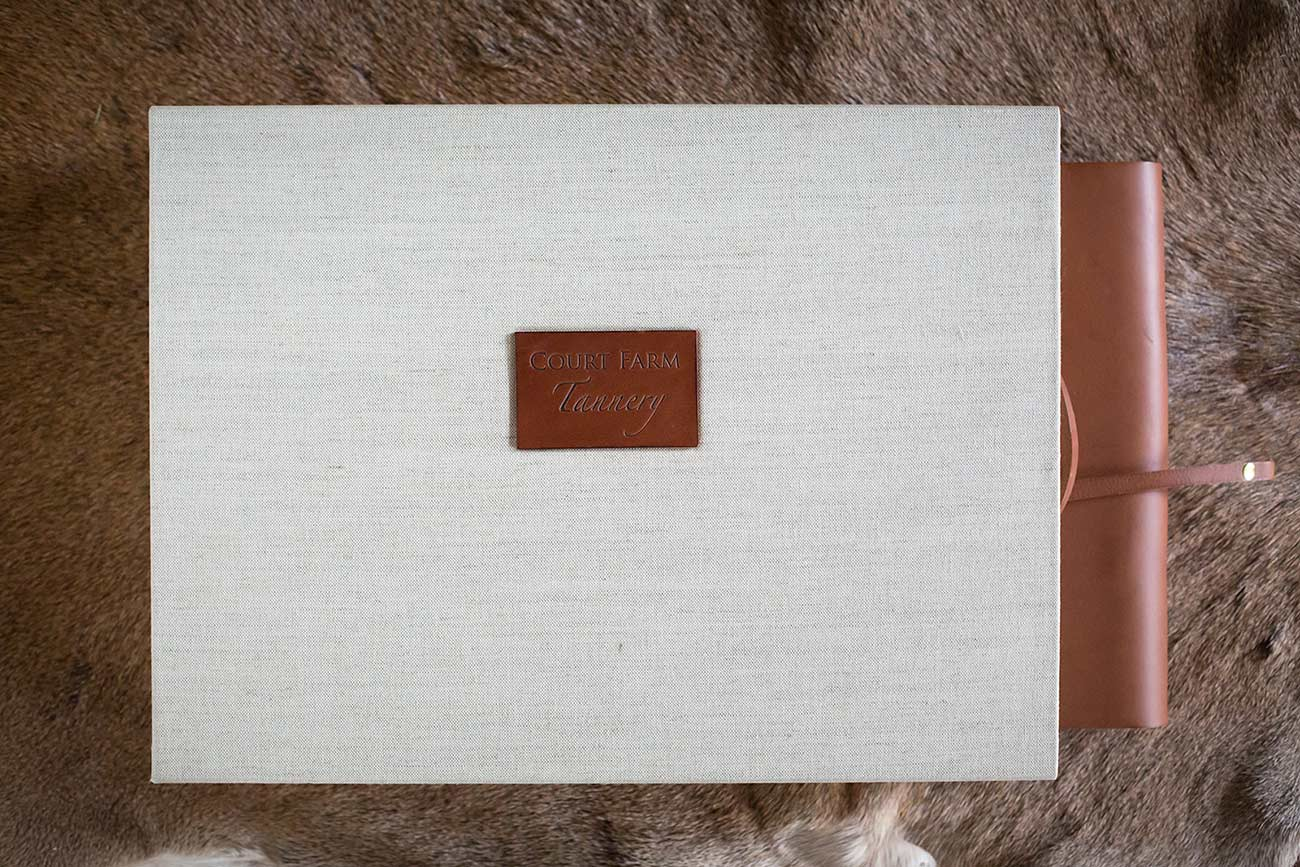 A slipcase case box for a leather album with a personalised leather name plaque