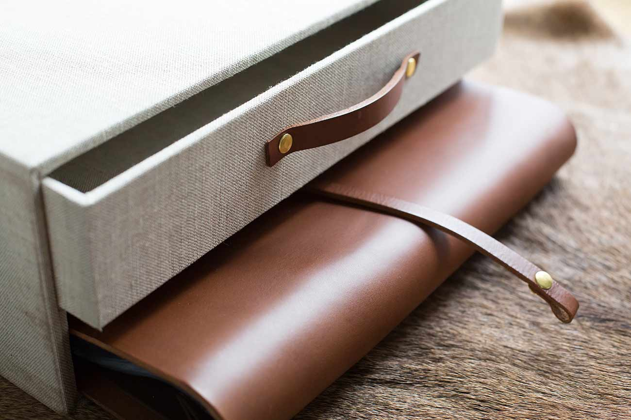leather album and matching draw with a leather pull tag
