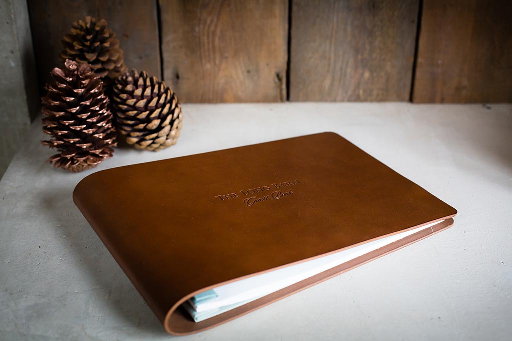 bespoke leather guest book in 3.5mm brown veg tanned leather and custom printed pages