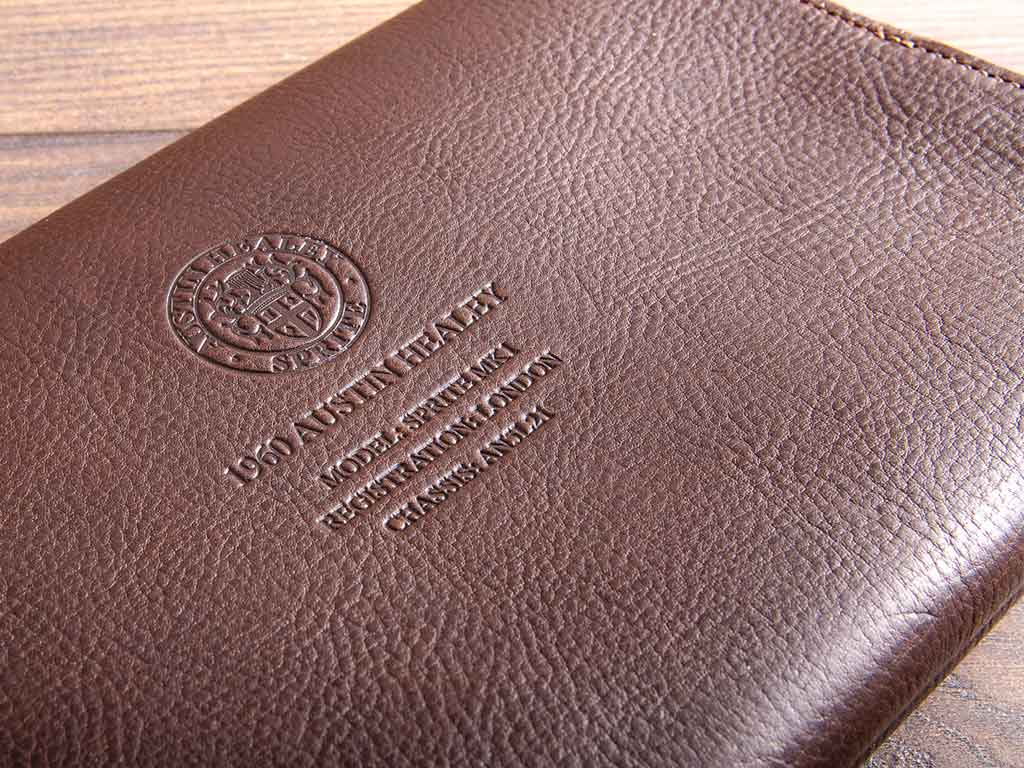 The Austin Healey Sprite's logo and vehicle details has been blind debossed into the cover of the document wallet