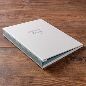 A4 personalised screw post binder in white and green buckram with foil embossing