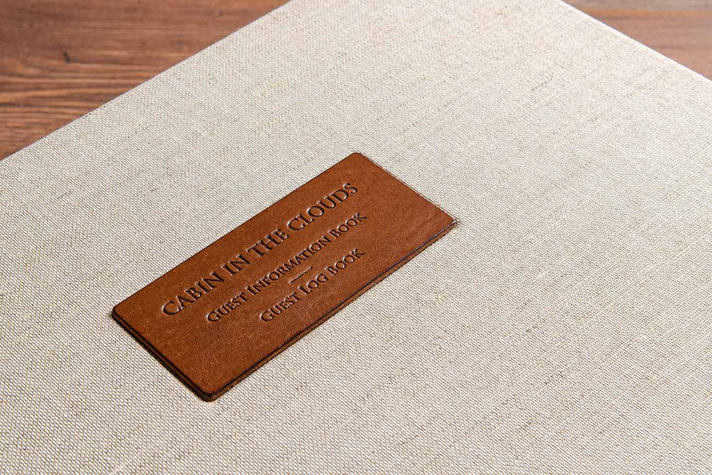 Leather plaque with blind debossed title of guest information book and guest book