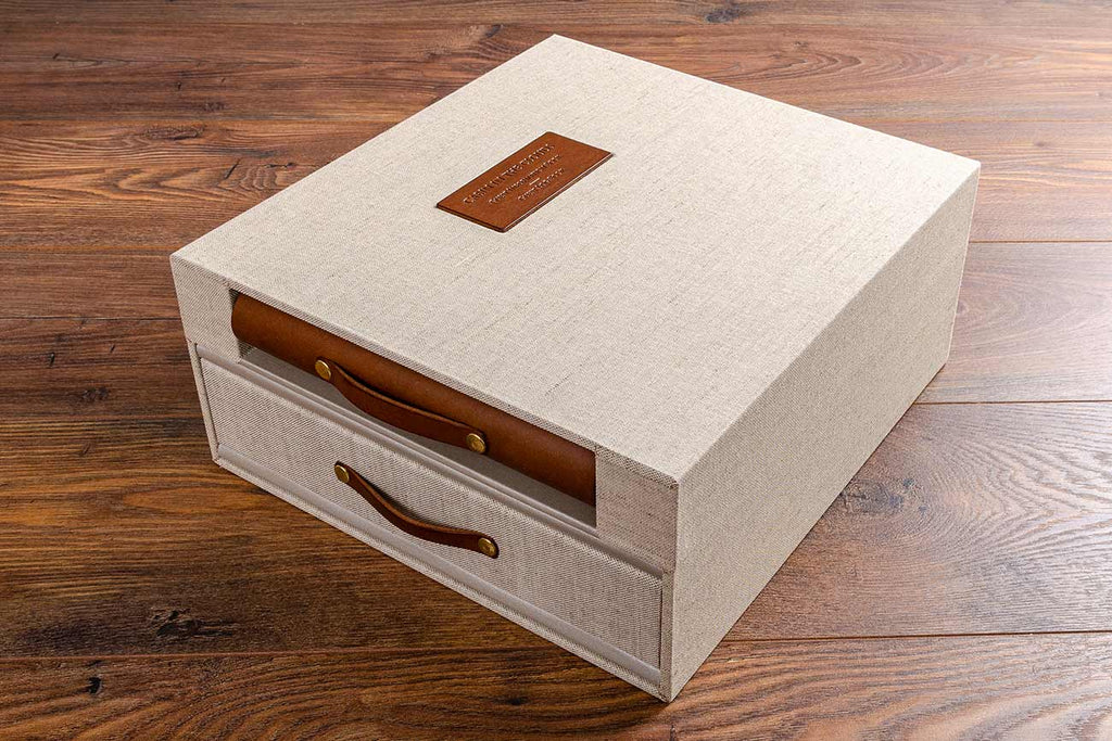 custom made box for a luxury guest house holding a guest information book and guest log book