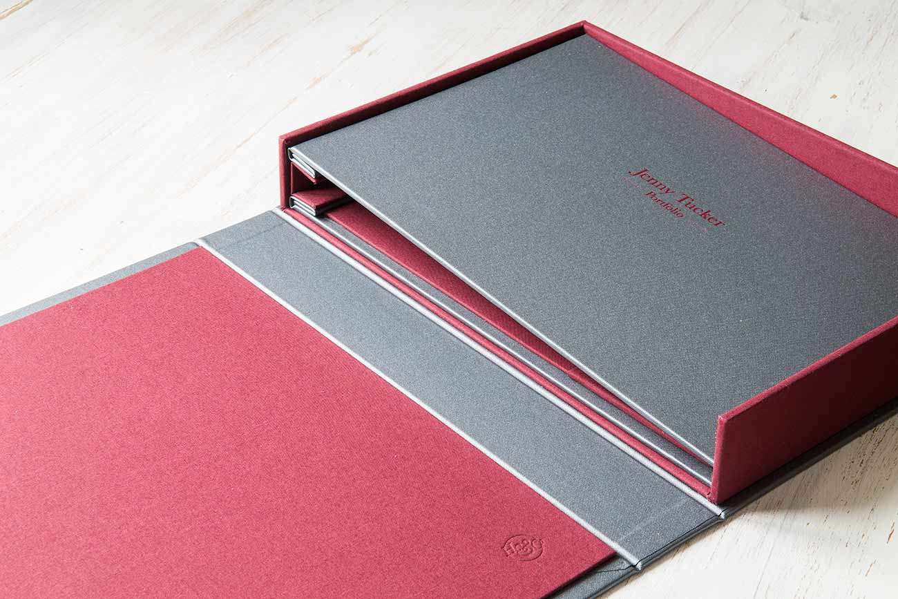 Portfolio book and box - A4 drop back clamshell box and hidden screw post portfolio with red foil personalisation.