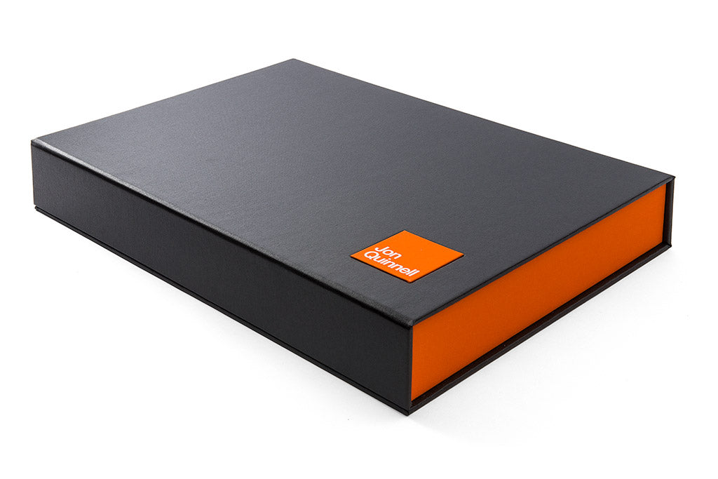 Half clamshell portfolio box in Charcoal buckram and Solo orange name plaque