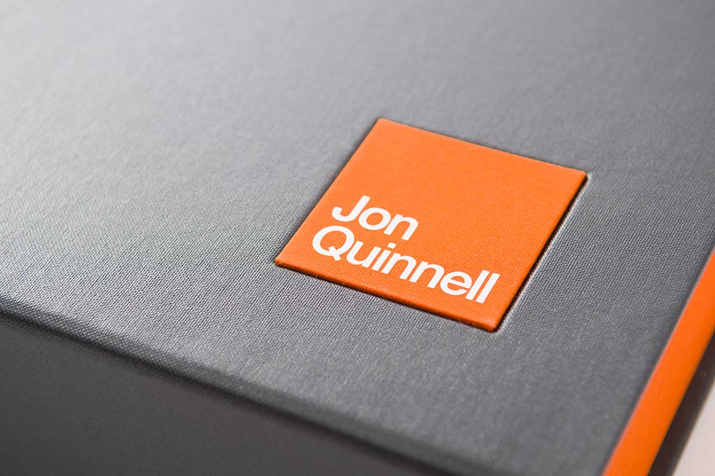 The name plaque in matching Solo orange book cloth has been foil stamped in white foil